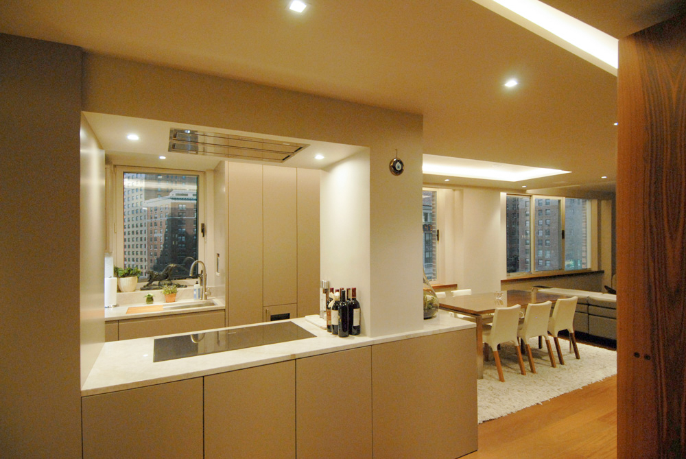 Contemporary renovation of New York 2 bedroom apartment with design by Soluri Architecture - living room & kitchen