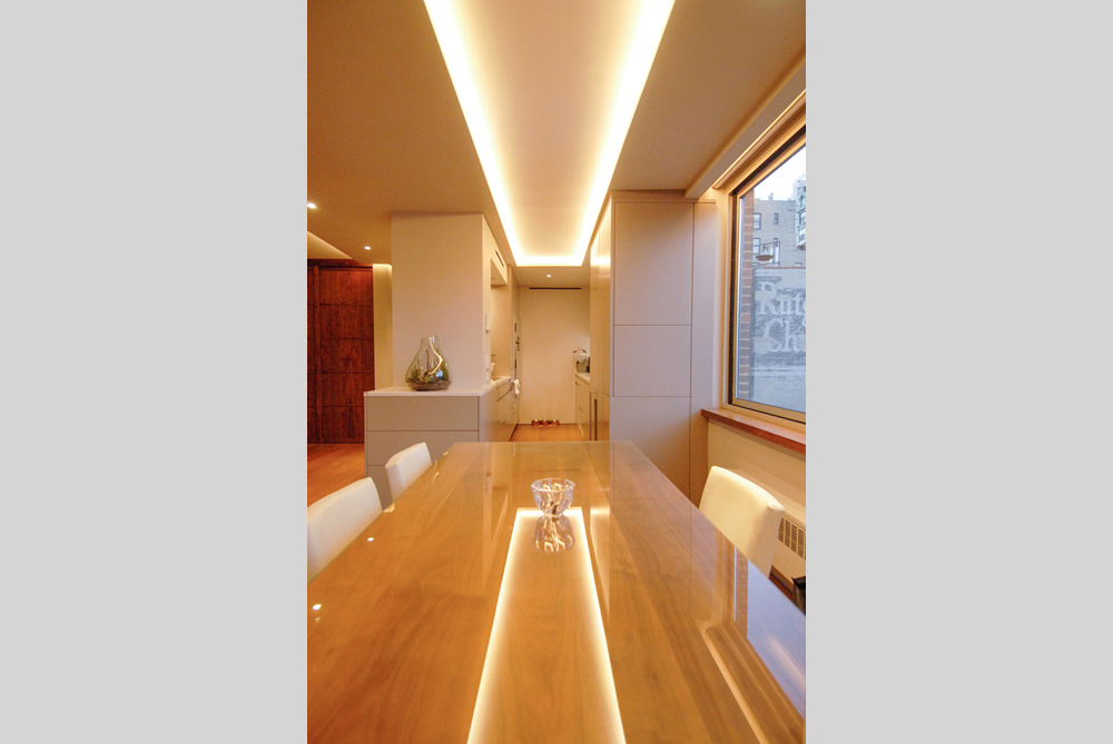 Contemporary renovation of New York 2 bedroom apartment with design by Soluri Architecture - kitchen & dining room